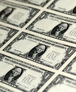 New dollar bills await serial numbers and seals at the Bureau of Printing and Engraving.