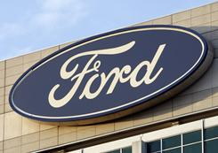 In this Oct. 26, 2009 photo, the Ford logo is seen on the automaker's headquarters in Dearborn, Mich.