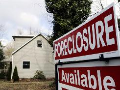 A sign on the lawn of a foreclosed home in Egg Harbor Township, N.J., in 2008.