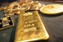 A 1-kilo gold bar on display along with gold coins at Stack's Rare Coins on New York City's 57th Street.