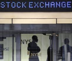 Traders wait in the lobby of the New York Stock Exchange before the opening bell in this October 2009 file photo.