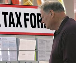 Taxpayers search through a sea of tax forms offered to the public as tax season kicks off.