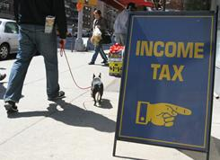 A sign advertises tax preparation services.