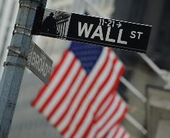 Street signs outside the New York Stock Exchange in a 2009 file photo.