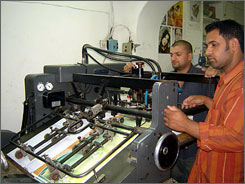 Qassem Abed and Ali Hussein, workers at Al-Shams printing house in Baghdad?s al-Bataween district, operate one of the many new presses in Iraq?s capital. Since the fall of the city in 2003, about 450 new print shops have opened.