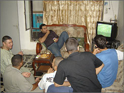 From left: Omar Hussein (on couch); Dherar Mostafa al-Taee, Mohammed Hassan, Ammar Ahmad, Hassan al-Taee and Ahmad Baban watch Monday?s World Cup match between the United States and the Czech Republic.
