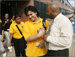 Principal Jeffrey Robinson shakes hands with ninth grader Daniel Tanner, 15, at the end of the school day at Baltimore Talent Development High School. The high school is on the cutting edge of a decade-long experiment to stem the nation's dropout crisis.