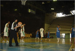 Players of the Shurta and Armenia clubs play in a game in the Premiere League. Players of the Iraqi Basketball Association play in an unheated gym with scuffed floors and get paid on average about $450 a month.
