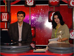 Your Fortune co-hosts Ali al-Bakri, left, and Hadeel al-Bayati, on the set. ?The strangest
