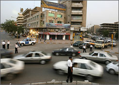 In addition to keeping cars moving, Baghdad's traffic police must deal with armed militias and speeding convoys, but they say most drivers obey them.