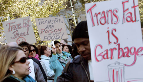 Protesters attend a rally against trans fats in New York City, in October. In December, health officials approved a ban on the use of trans fats in city eateries. Philadelphia followed suit on Feb. 15, forcing chefs to find palatable substitute oils.