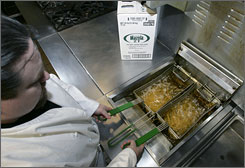 Sean Malloy, chef at the Rutgers-Newark student center in Newark, N.J., cooks french fries in trans fat free oil. Health analysts say the nation's fixation with trans fats is drawing attention away from other important reasons Americans' diets are so bad for their hearts.
