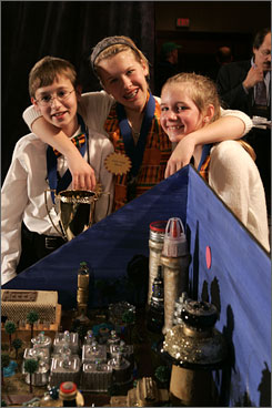 Jake Bowers, left, Emily Ponti and Krisha Sherburne of St. Thomas More School in Baton Rouge with their winning entry.