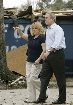 President Bush tours rebuilding efforts in a neighborhood affected by Hurricane Katrina with Gulf Coast community federal block grant recipient Cheryl Woodward Thursday in Long Beach, Miss. Bush will also meet with community leaders and promote education reform on the trip.