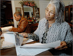 Ruth Adair Nash and her brother Everett Adair look over some of their family history paperwork at Ruth's home in Bartlesville, Okla. They both are freedmen, descendants of slaves once owned by Cherokees.