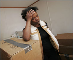 Regenia Scott boxed her belongings after she was told by the FEMA to move from her mobile home in Hammond, La., Sunday. The FEMA site, set up for victims of Hurricane Katrina, housed 58 families that were given 48 hours to move.