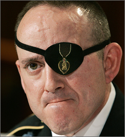 Wounded U.S. Army Sergeant John Daniel Shannon testifies Monday in Washington before a U.S. House subcommittee about the care of wounded soldiers at Walter Reed Army Medical Center. The patch on his left eye is embroidered with the Purple Heart.