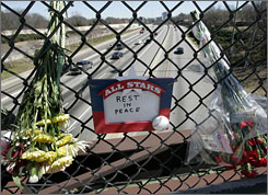 Flowers and messages line the fence at the scene of the bus wreck in Atlanta.