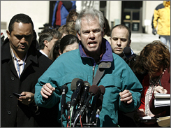 """Denis Collins, a jury member in the criminal case against Lewis """"Scooter"""" Libby, speaks to the media at the U.S. Federal Court in Washington."""