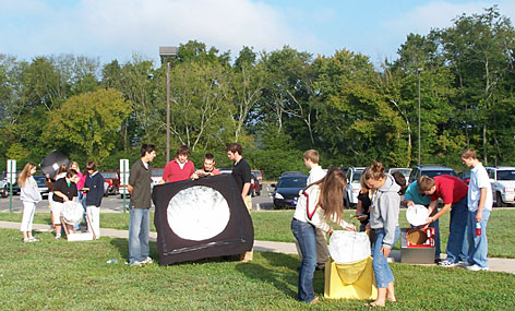 Luajean Bryan's pre-calculus students design and build parabolic devices that harness solar heat to cook marshmallows.