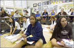 Students at Kamehameha High School watch a video during their Hawaiian language class.