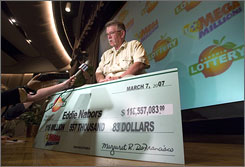 MegaMillions lottery co-winner Ed Nabors is interviewed by reporters during a news conference held after he showed up at the Georgia Lottery office to turn in his winning ticket in Atlanta.