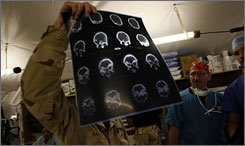 Air Force Lt Col. Doctor Jeffrey Bailey, chief of trauma surgery, looks at the CT scan of a patient who had sustained a gun shot wound to the head in the ER of the Air Force Theater Hospital in Balad, Iraq.