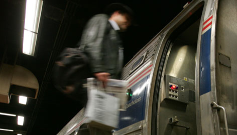 Commuter Scott Clinton steps on an express train at 30th Street Station in Philadelphia heading to Paoli, Pa., in this 2006 USA TODAY file photo. Congress and the White House are in rare agreement that it makes sense to expand Amtrak service where demand is the greatest.