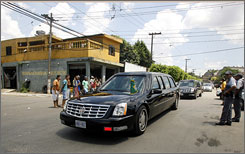 President Bush's motorcade passes through a poor neighborhood in Guarulhos, east of Sao Paulo, Brazil.