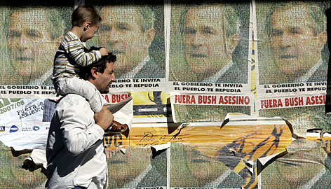 Posters portraying President Bush on Friday in Montevideo.