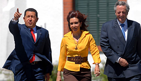 Argentina's President Nestor Kirchner, right, his wife Cristina Fernandez de Kirchner, center, and Venezuela's President Hugo Chavez walk Friday at the Presidential Residence in Buenos Aires.
