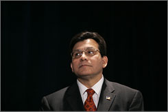 Attorney General Alberto Gonzales listens as he is introduced prior to addressing the International Association of Privacy Professionals Friday in Washington.
