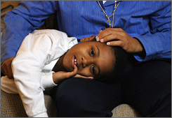 Deanne Neely and her 6-year-old son Kameron, wind down at the end of the day on the couch in their Tucker, Ga. apartment.