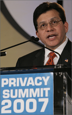 Attorney General Alberto Gonzales addresses the International Association of Privacy Professionals, Friday. Sen. Charles Schumer branded Gonzales, a former White House counsel, as one of the most political attorneys general in recent history Sunday.