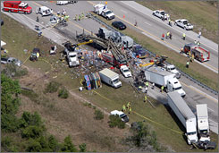 Investigators looks over the scene of the multi-vehicle accident on the Florida Turnpike on Tuesday near St. Cloud, Fla.