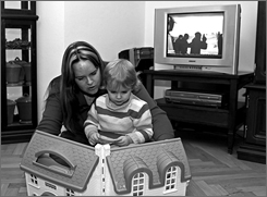 Candice Osborn and her daughter, Hunter, play at their home in Germany.