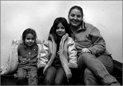 Tanya Garcia with daughters Trinity, 6, and Sophia, 4. Garcia slept with three phones so she wouldn't miss a call from her husband.