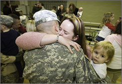 Candice Osborn, Jeremy Osborn and their daughter, Hunter, are reunited during a ceremony Feb. 14 in Friedberg, Germany. Psychologists say extended deployments can be particularly hard on loved ones.