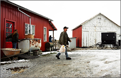 Brandon Hoyt, who is not Amish, leaves Mary's Amish Kitchen near Pfeiffer Station, Ohio. The kitchen and other homemade bakers in the Amish enclave have come under scrutiny from state regulators for selling meats and cheeses without a license and cream pies and pumpkin rolls without the required refrigeration.