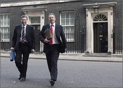 "Prime Minister Tony Blair, right, with Parliamentary Private Secretary Keith Hill, leaves the prime minister's official residence to attend the weekly ""Questions"" session in the House of Commons. Many members of Blair's own party oppose his plan to overhaul nuclear-armed submarines."