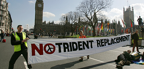 Protestors gathered near the Houses of Parliament before a vote on Great Britain's nuclear-armed submarines. Anti-nuclear campaigners say the Trident system could cost three times as much as the government's estimate.