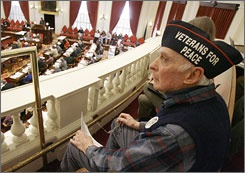 Wearing a 'Veterans for Peace' hat, World War II veteran Larry Hamilton listens to debate on a resolution demanding the withdrawal of U.S. troops from Iraq at the statehouse in Montpelier, Vt. Groups from both sides of the war debate will converge in Washington, D.C., Friday.