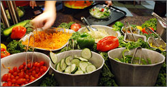 University of Missouri freshmen fill their plates at a salad bar in Columbia, Mo. Research shows that diets high in fruits and vegetables decrease the risk of heart disease, cancer, diabetes and help with weight control.