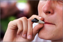 A young man takes a puff of a pot joint in Washington, D.C. Marijuana use rose from 27.9 percent in '93 to 33.3 percent in '05.
