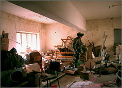 Members of a U.S. Army Stryker battalion search a storeroom in an abandoned school in Baqouba, 35 miles northeast of Baghdad on Wednesday. The unit was sent from Baghdad to Diyala province this week to help quell increasing violence there.