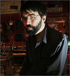 Author Joe Hill, using a pen name, poses in a restaurant in Portsmouth, N.H. He was born Joseph Hillstrom King and is the older son of famed writer Stephen King.