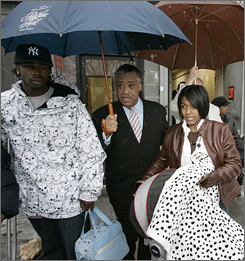 The Rev. Al Sharpton, center escorts shooting victim Trent Benefield, left, and Sean Bell's fiance Nicole Paultre-Bell, right, to their waiting cars after Sharpton commented on the grand jury's decision Friday, in New York City. The indictments will be unsealed by Queens D.A. Richard Brown on Monday.