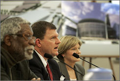 Seattle SuperSonics basketball owner Clay Bennett, center, flaked by former NBA star Bill Russell, left, and Linda Hull, lead lobbyist for the group, testified at a House Finance Committee hearing in Olympia, Wash., last month. Behind them is an early drawing of the proposed arena.