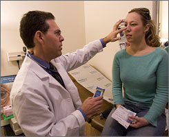 Dr. Clifford Bassett conducts an allergy exam with allergy sufferer Dagmar Fisher in his office.