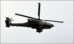 A U.S. Apache helicopter circles over Baghdad during a patrol in February.